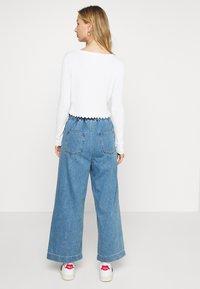 Monki - LIZETTE TROUSER - Relaxed fit jeans - blue medium - 2
