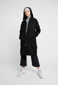 Monki - LEMON HOODED COAT - Abrigo - black dark - 1