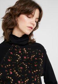 McQ Alexander McQueen - HYBRID DRESS - Sukienka dzianinowa - darkest black - 5