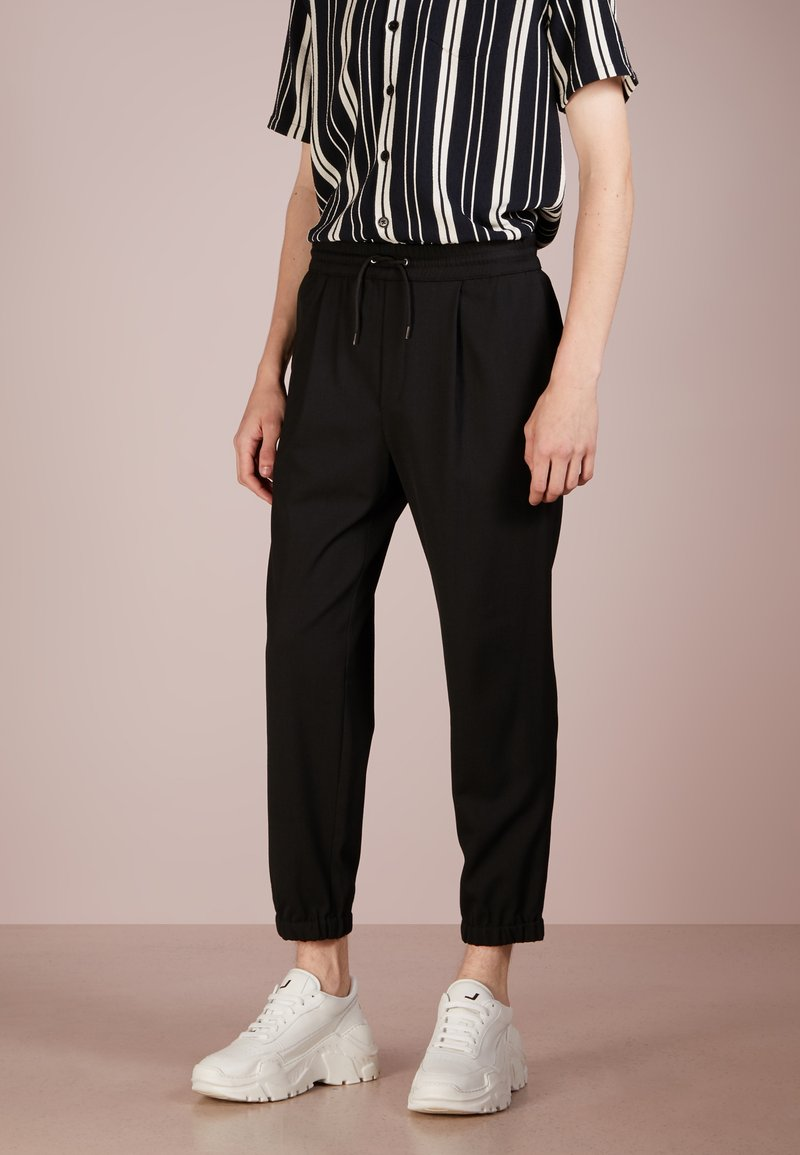 McQ Alexander McQueen - TAILORED TRACKPANT - Stoffhose - darkest black