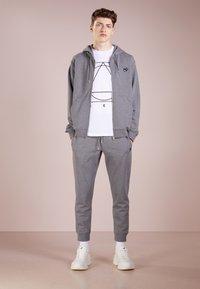McQ Alexander McQueen - Tracksuit bottoms - grey melange - 1