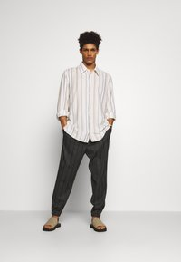 McQ Alexander McQueen - TAILORED TRACKPANT - Trousers - charcoal - 1