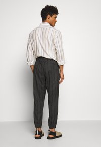 McQ Alexander McQueen - TAILORED TRACKPANT - Trousers - charcoal - 2