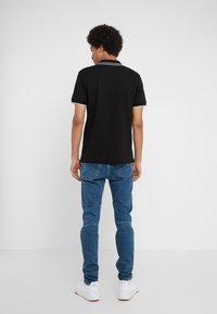McQ Alexander McQueen - Poloshirt - darkest black/white - 2
