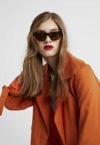 McQ Alexander McQueen - Sonnenbrille - brown - 1