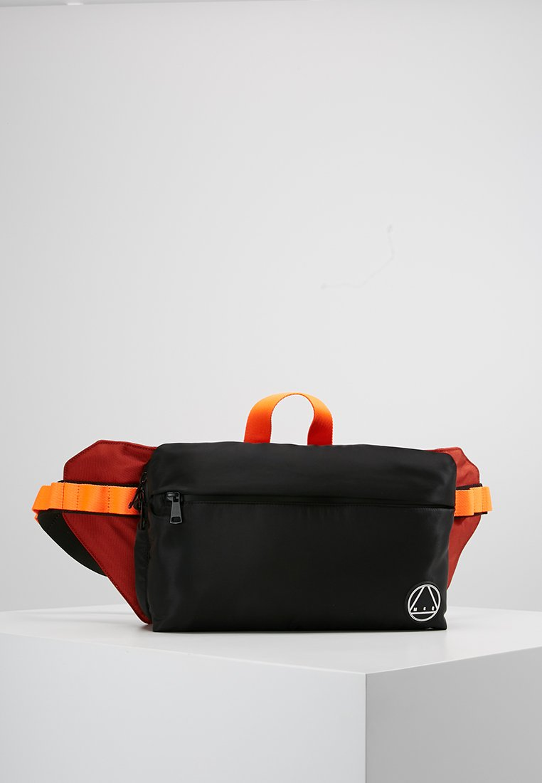 McQ Alexander McQueen - WAIST BAG - Riñonera - black/rust orange