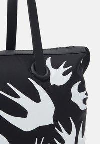 McQ Alexander McQueen - MAGAZINE TOTE SWALLOW - Tote bag - black - 6