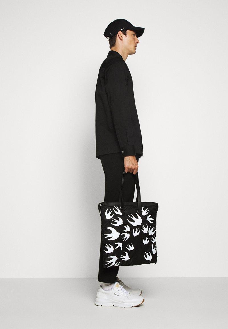 McQ Alexander McQueen - MAGAZINE TOTE SWALLOW - Tote bag - black