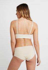 MAGIC Bodyfashion - COMFORT BRA SPAGHETTI STRAPS - Bustier - cream