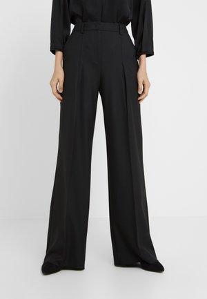 CAPRAIA - Pantaloni - black