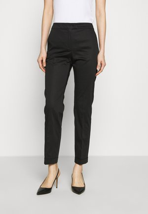 CEMENTO - Trousers - black