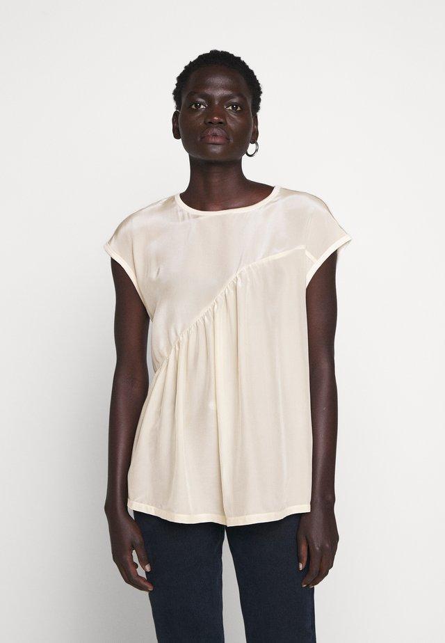 CUPIDO - Bluser - attiliosa white