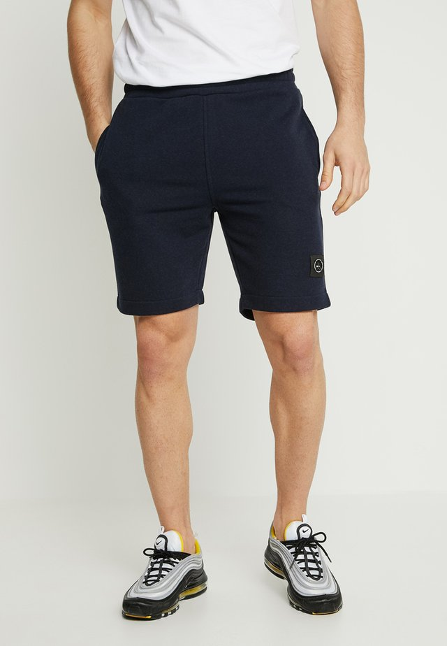 SIREN - Tracksuit bottoms - navy