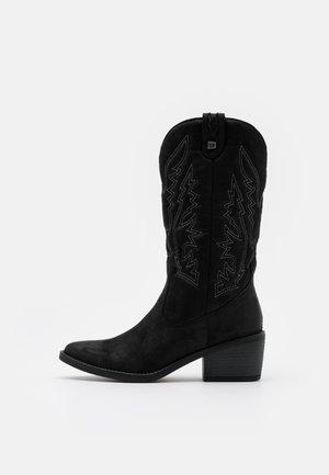 TANUBIS - Kovbojské/motorkářské boty - black