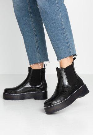 STIRM - Kotníkové boty na platformě - black