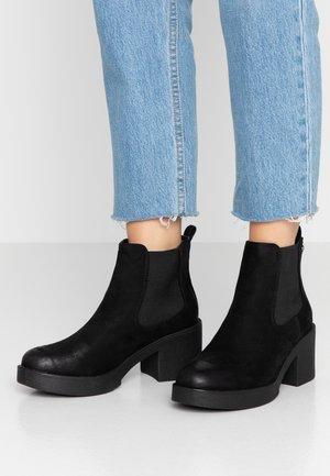 ERIS - Korte laarzen - black