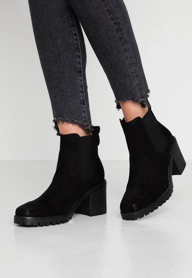 ZEUS - Ankle boots - black