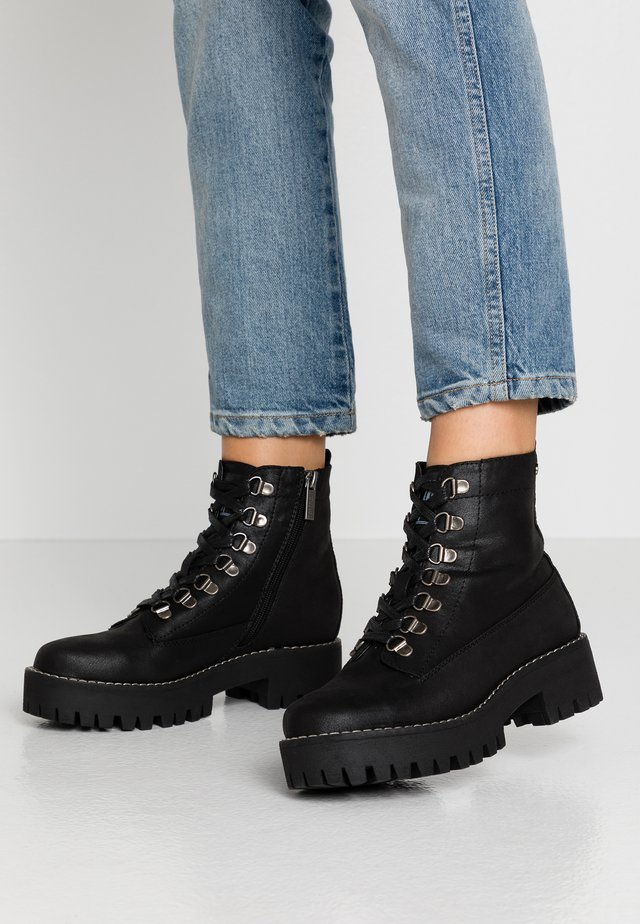 NEW ONDA - Platform ankle boots - black