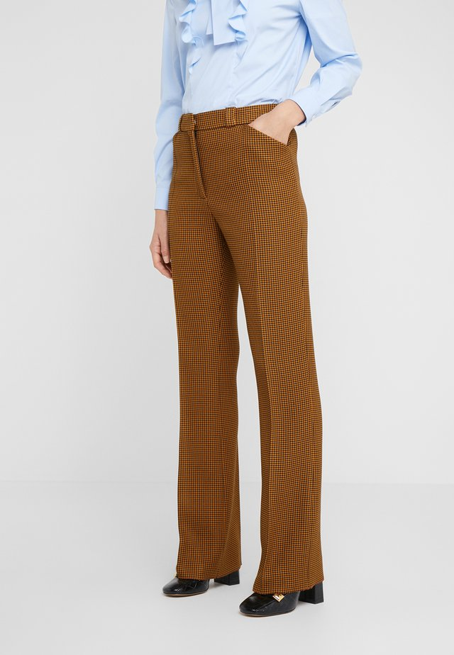 EVE - Spodnie materiałowe - dark yellow