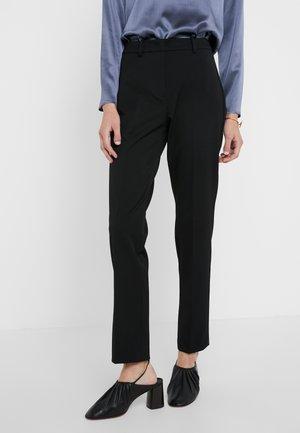 MADRE - Spodnie materiałowe - schwarz