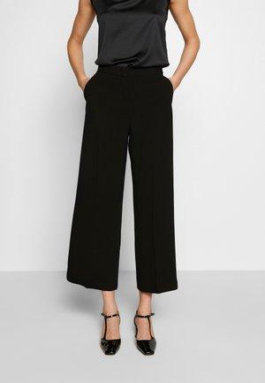 LIEGI - Trousers - schwarz