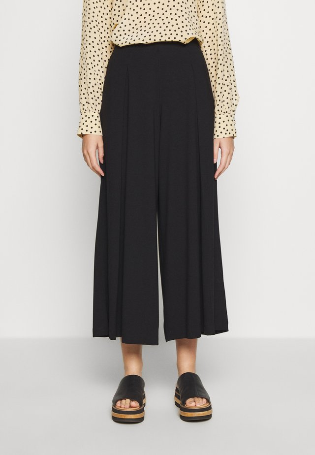 PATNER - Trousers - schwarz