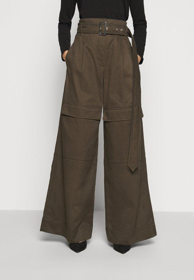 ORNATI - Flared jeans - braun