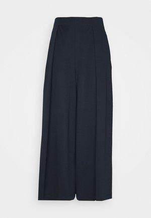 TURCHIA - Trousers - ultramarine