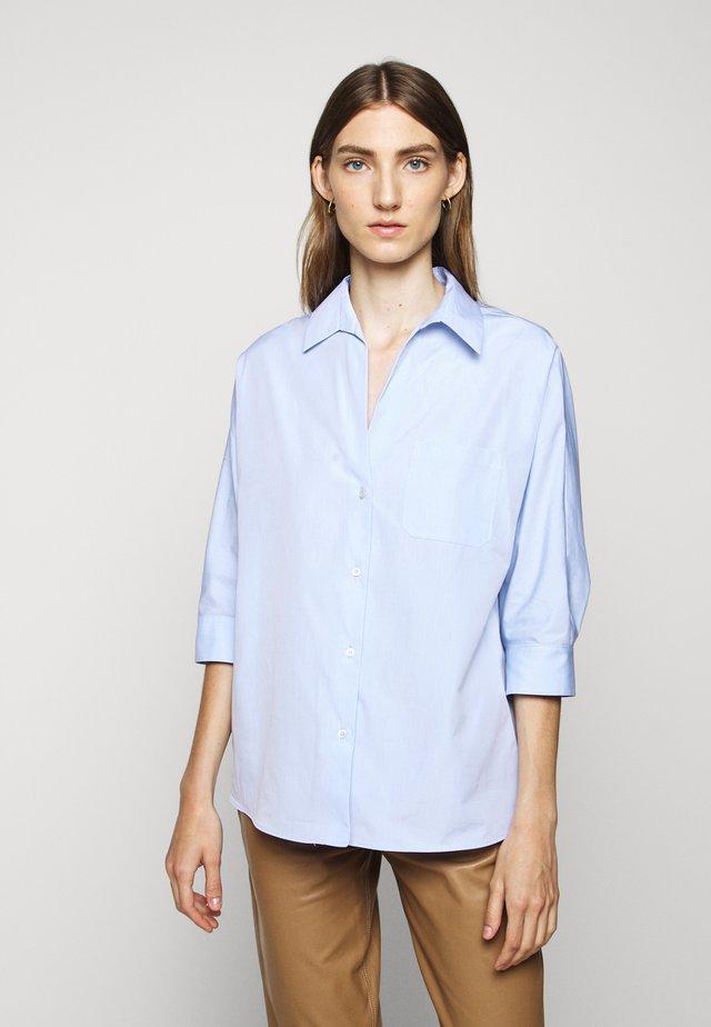 ERSILIA - Button-down blouse - light blue
