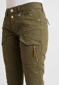 Mos Mosh - HURLEY DECO CARGO PANT - Spodnie materiałowe - army - 5