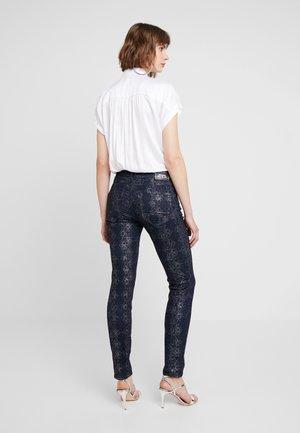 COBRA PANT - Slim fit jeans - dark blue