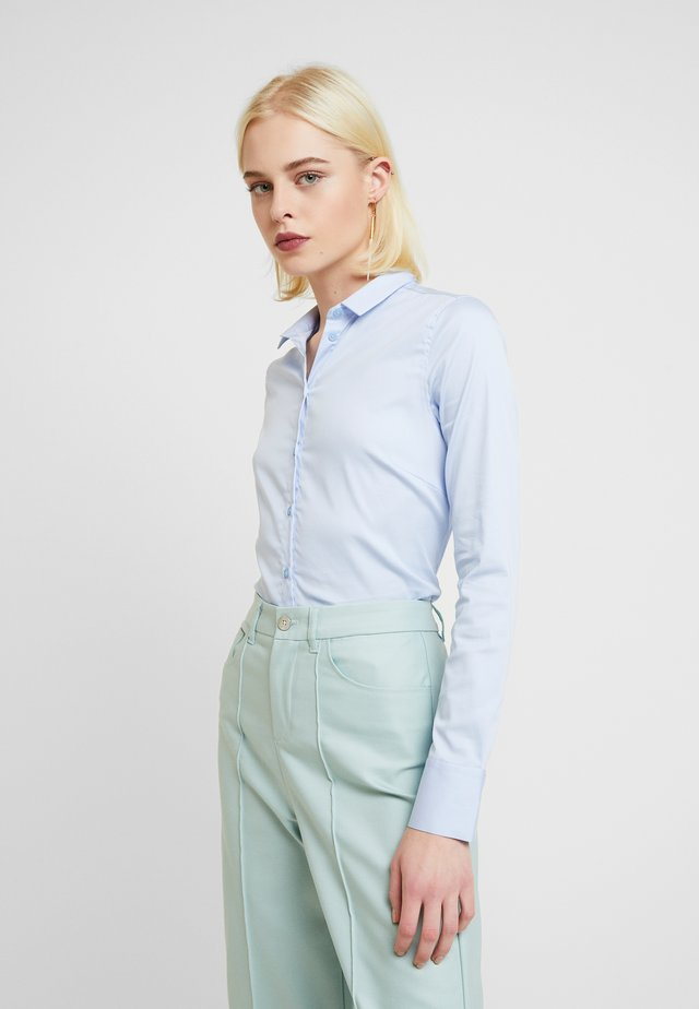 TILDA  - Button-down blouse - light blue