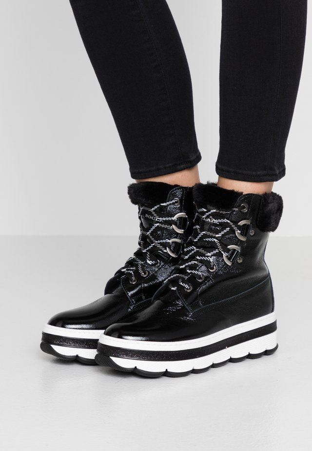 FRANCY - Platform ankle boots - nero