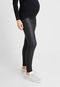 New Look Maternity - Jeans slim fit - black - 0