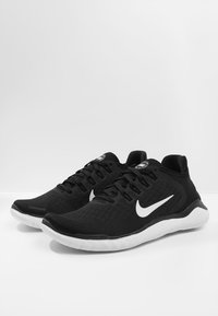 Nike Performance - Laufschuh Natural running - black/white - 2