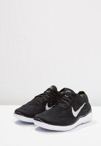 Nike Performance - FREE RN FLYKNIT 2018 - Minimalist running shoes - black/white - 2