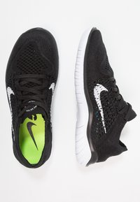 Nike Performance - FREE RN FLYKNIT 2018 - Minimalist running shoes - black/white - 1