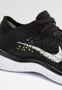 Nike Performance - FREE RN FLYKNIT 2018 - Minimalist running shoes - black/white - 5