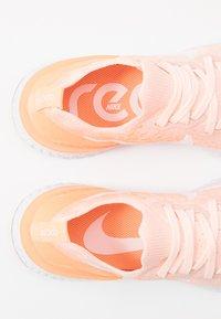 Nike Performance - EPIC REACT FLYKNIT 2 - Hardloopschoenen neutraal - sunset tint/white/orange pulse - 5