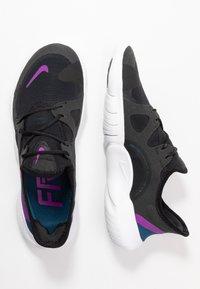 Nike Performance - FREE RN 5.0 - Minimalist running shoes - black/vivid purple/valerian blue - 1