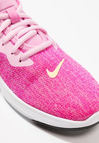 Nike Performance - FLEX TRAINER 9 - Competition running shoes - pink rise/melon tint/laser fuchsia - 5