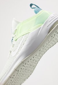 Nike Performance - AIR MAX BELLA TR 2 - Sports shoes - spruce aura/white/barely volt/cerulean