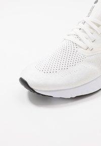 Nike Performance - ODYSSEY REACT 2 FK JDI - Neutral running shoes - summit white/psychic purple/laser fuchsia/yellow pulse/white - 5