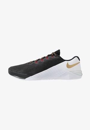 METCON 5 - Sports shoes - black/metallic gold/white/university red