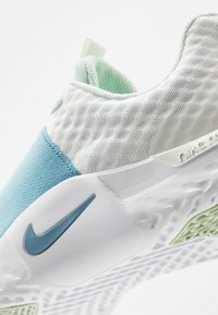 Nike Performance - RENEW IN-SEASON TR 9 - Sports shoes - spruce aura/cerulean/pistachio frost/barely volt-white - 5