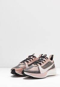 Nike Performance - ZOOM GRAVITY - Neutral running shoes - black/platinum tint/stone mauve/metallicred bronze/smokey mauve - 2
