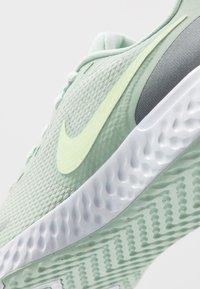 Nike Performance - REVOLUTION 5 - Zapatillas de running neutras - pistachio frost/barely volt/smoke grey - 5
