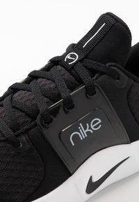 Nike Performance - RENEW IN-SEASON TR 10 - Sports shoes - black/dark smoke grey/white - 5