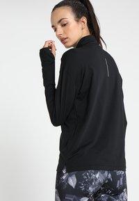 Nike Performance - Camiseta de deporte - black/silver - 2