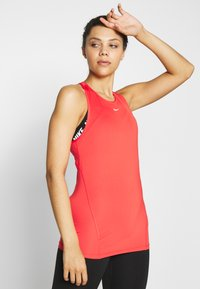 Nike Performance - TANK ALL OVER  - Sports shirt - track red/white - 0